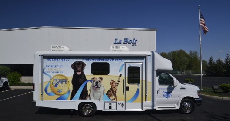 mobile veterinary clinic passenger side view